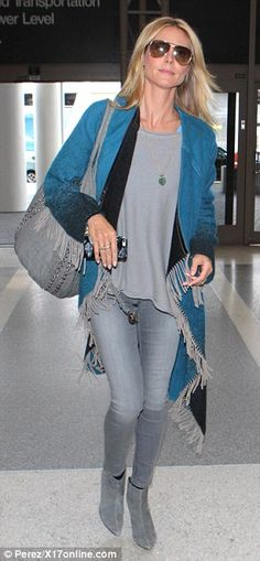 Shades of grey: Heidi complimented her blue fringe wrap with tight grey jeans, grey bag an...