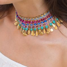 "The St. Barths Statement Choker Necklace features semi-precious and gold dipped accents that bring color, sparkle and movement to jet-setting and everyday adventures!    Necklace measures 12"" long x 1 1/2"" wide with 3 1/2"" extender.    Materials: 22K gold-plated brass elements with semi-precious Lapis, Turquoise, and Quartz stones; Swarovski gold mushrooms.    Designed & handcrafted in the USA with components from around the world."
