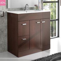 Grand meuble plan vasque pour salle de bain réalisé en panneaux de particules et en bois wengé. Équipé de 2 portes et 2 tiroirs avec système de fermeture amortie. Vasque en porcelaine offerte.