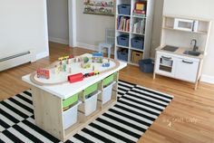 Ikea Hack custom train and activity table with TONS of storage - this EASY DIY project is a great way to get toys off the floor and organized.