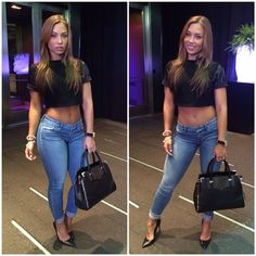 Nicole Mejia with jeans and high heels