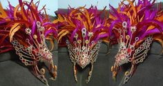 This is a very impressive colorful costume. One of our favorites. The color combo is just magnificent. The designer used pink, red, and orange rooster tails on