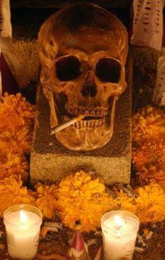FOR METRO - A calavera rests on a grave Monday Oct. 31, 2005 in the Panteon Municipal in Xoxocotlan, Oaxaca, Mexico during Dia De Los Muertos celebrations. PHOTO BY EDWARD A. ORNELAS/STAFF Photo: EDWARD A. ORNELAS, SAN ANTONIO EXPRESS-NEWS / SAN ANTONIO EXPRESS-NEWS