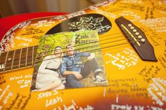 They used a guitar for guests to sign on, with a faux vinyl record cover using one of their engagement photos. .......LOVE THIS IDEA TOO :)