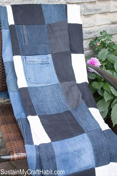 Denim picnic blanket DIY upcycle- SustainMyCraftHabit.com. Checker board nlanket made from old jeans. The step-by-step tutorial for this useful home decor project is included.