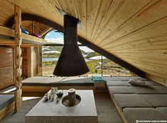 This picturesque mountain lodge is situated on the edge of the Åkrafjorden fjord in western Norway and was realised by the creative minds at Snøhetta. The structure is composed of two curved steel beams spanned…