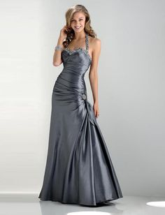 """Start out searching for your perfect long maxi silver prom dress by flipping through magazines and online to see what kind of dress you are most attracted to. Then hit the stores with an idea in mind of what you are looking for. Try on as many dresses as you can; your idea of the """"perfect dress"""" may not be as well suited for you as another style. Don't limit yourself."""