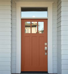 Dreaming of a red front door but hoping for something a little more subdued? Consider a terra-cotta shade, such as Cavern Clay by Sherwin-Williams, to brighten up the exterior of your home. Coral Front Doors, Best Front Door Colors, Best Front Doors, Front Door Paint Colors, Best Paint Colors, Painted Front Doors, Paint Colors For Home, Painted Exterior Doors, Colored Front Doors