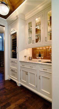 Butler's Pantry and Bar.  I would do it in a natural wood color instead of white, but I love the design.