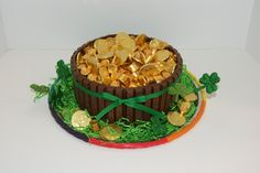 Pot-O-Gold Cake. 40 Kit-Kat sticks, 2 bags of Rolos, 5 bags of Gold coins. 2 Layer cake under it all. St. Patrick's Day
