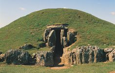 "Bryn Celli Ddu Burial Chamber, Anglesey, Wales. ""Impressive Neolithic chambered tomb, with partially restored entrance passage and mound, on the site of a former henge monument."