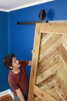 Sliding barn doors are a great way to add rustic appeal to your home without having to rip open and reframe your walls. Learn how to build one today! Home Improvement Projects, Home Projects, Pallet Projects, Woodworking Projects, Diy Barn Door, Barn Doors, Recycled Door, Build Your Own Shed, Sliding Door Design