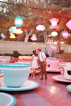 Vintage Engagement Photo Shoot in Disneyland. I'd love to do this with my fiancé and it would go perfect with our wedding theme of Alice in Wonderland