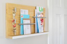 See the tutorial for this stylish wall mail organizer and key holder