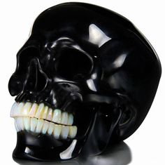 Obsidian skull with Opal teeth. Galactic-stone