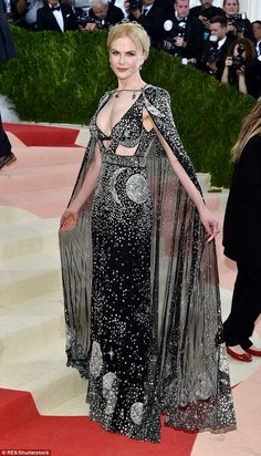 Bewitching: Nicole Kidman works her magic in a bejewelled black gown and cape at the Met Gala in New York on Monday