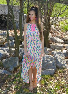 Make a SPLASH in this gorgeous high low maxi dress! Between It's Neon Print & Key Hold Neckline You're Sure To Make A Statement!