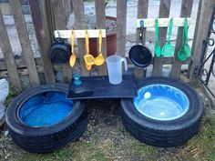 Placing a bowl in the center of a tire is a great idea for a simple sensory tub for infants/toddlers