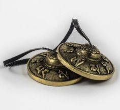Antique Handmade Bronze Tingsha cymbal with auspicious Tibetan Mantra and Lotus symbol from Asthamangala. These Meditation bells are tied together with high quality durable leather cord. Tibetan Mantra, Nepal Trekking, Singing Bowl, Leather Cord, Pocket Watch, Meditation, Bronze, Antiques, Handmade