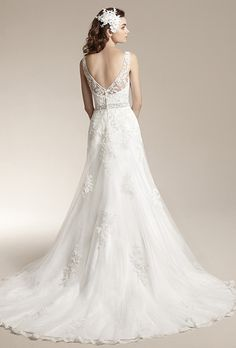 Brides: Jasmine Collection. Romantic tulle gown with scallop hem, beaded waistband, lace appliques on skirt, sheer lace overlay at neckline and open v-back.