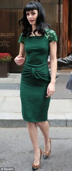 Colour chameleon: Krysten Ritter swapped emerald green for fuschia as she legged it around New York on Thursday