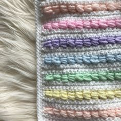 Ravelry: Rainbow puff baby blanket pattern by Zoe Bartley Crochet Baby Blanket Free Pattern, Granny Square Crochet Pattern, Afghan Crochet Patterns, Baby Patterns, Crochet Stitches, Crochet Afghans, Crochet Rugs, Crochet Hooks, Crochet Cactus