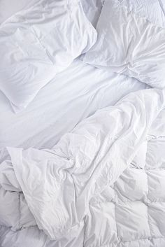 I want a big, tall, white bed with HUGE puffy sheets that I can get lost in.