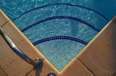 porcelain pool tile - want to upgrade your inground pool with a tile surface? Here's a breakdown of your options and how much they might cost! #swimmingpools #ingroundpools #poolideas
