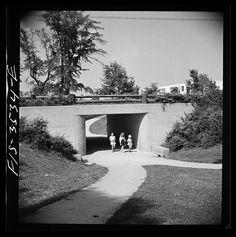 Greenbelt, Maryland. Federal housing project. Children returning home from school through an underpass