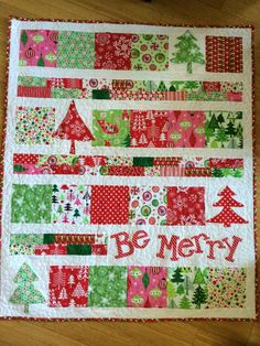 "cute kid's christmas quilt. http://www.jedicraftgirl.com/?s=be+merry The quilt measures 42″ x 35.5″ finished – so a nice wall size. The blocks are cut 6″ The scrappy strips are cut 2″ and pieced together randomly in all different lengths. The white sashing is also cut 2″ There are plain 6″ white blocks where the trees go and then a white rectangle block where the words ""Be Merry"" go.  The font is called Candy Randy.  I hope this is helpful!!"