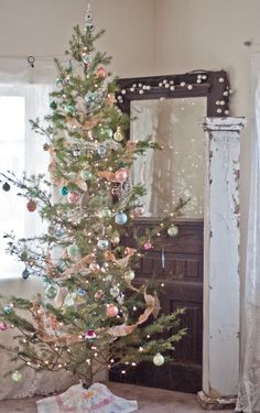 Love the vintage Christmas tree and the architectural pieces beside it. The tree is so Charlie Brown-ish!