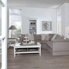 Fijn sfeertje in deze woonkamer. Mooie bij elkaar passende kleuren.