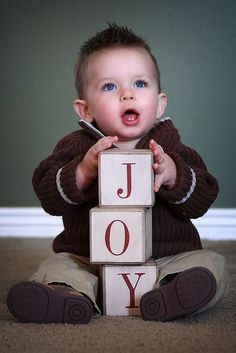 Fun way of taking a picture of a child, using blocks to spell JOY #Christmas…