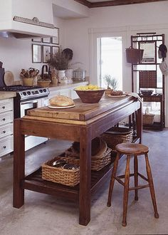 awesome kitchenisland | it looks like a granite top table with a custom butcher block placed on top…but maybe they bought it this way. Either way, I'm loving it!