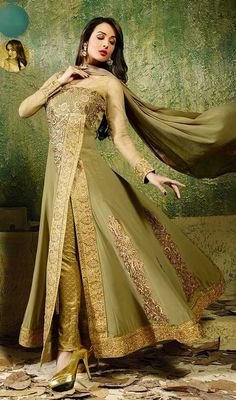Stun the crowd similar like Malaika Arora Khan in this beige, deep mehendi green and gold color georgette net embroidered pant style suit. The pretty butta, dangler and resham work a substantial characteristic of this dress. #BollywoodFancySuitDesign