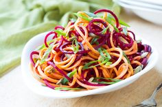 Amazing fresh raw beet and sweet potato salad with scallions and pepitas! This is not your average beet salad.