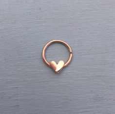 Love Heart Septum Ring - 22ct Rose Gold Vermeil - Jewelry Ring Piercing Daith Helix Rook by AliceRubyStudio on Etsy https://www.etsy.com/listing/231956790/love-heart-septum-ring-22ct-rose-gold