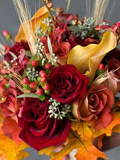 fall bouquet - STUNNING… roses, calla lilies, mokara orchids, hypericum berries, eucalyptus rounded out with fall leaves. What an amazing aroma this bouquet {by Divine Design and Events} will have.