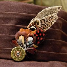 Feather Pin - Game Feather on Cartridge top | empty shotgun shells | spent shotshells | empty 12 ga | once fired shotgun shells | empty hulls spent 12ga hulls | shotgun hulls | empty 12 gauge