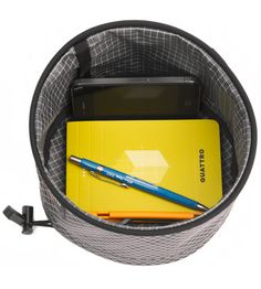 great idea for traveling...or, I'd use this even more than that. It's a collapsible container to hold your cell, your keys, etc... if you dont have time to properly store it all, just pull the drawstring and run out the door with it.