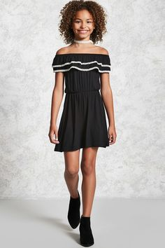 Forever 21 Girls - A knit dress with an elasticized round neckline that can be worn off-the-shoulder featuring tiered flounce layers with contrast pom-pom trim, an elasticized waist, and short sleeves.