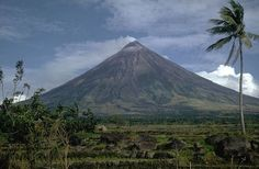 Philippine News - The Mayon volcano in eastern Albay province, one of the most active in the Philippines, has begun to eject large quantities of lava rocks, spilling up to half a mile down its slopes, prompting the evacuation of thousands of local villagers.