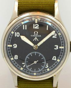 1944 Vintage Omega WWII British Military Stainless Steel watch with Original Black Dial with White Arabic Numbers with Iconic 30 T2 Movement