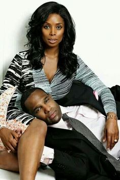 Tasha Smith and husband.