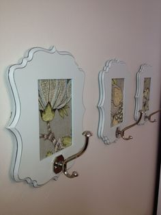 We are in love with these DIY coat hooks using Hobby Lobby frames, scrapbook paper and hooks