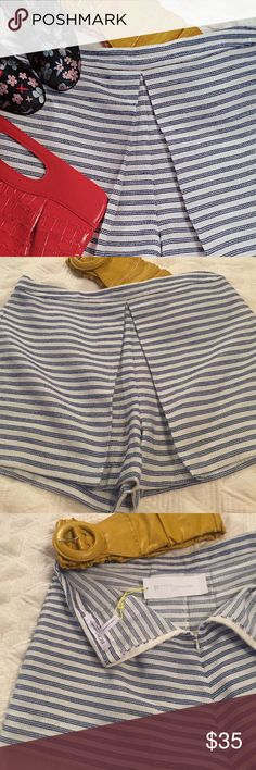 Bcbgeneration shorts sz 10 These adorable and trendy blue and white striped shorts giving the illusion of a skirt without being a skirt.  No pockets and zips up the back. BCBGeneration Shorts