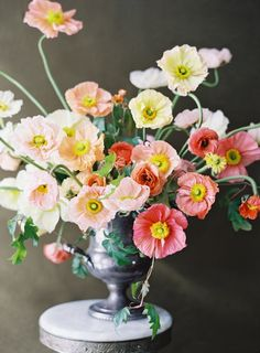 Spring poppies arranged by Sarah Winward of Honey of a Thousand Flowers