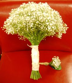 Baby's Breath Wedding Bouquet and Boutonniere.  The bouquet is a little too big but I like the boutonniere.