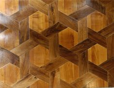Parquet floor using shuttles and hexagons, in walnut and cherry wood, from Atelier des Granges