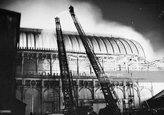 London firemen try to contain the fire which destroyed the Crystal Palace exhibition hall in Sydenham, south London. 1936